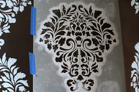 I finally stenciled a wall! With this gorgeous pattern in our half bathroom...